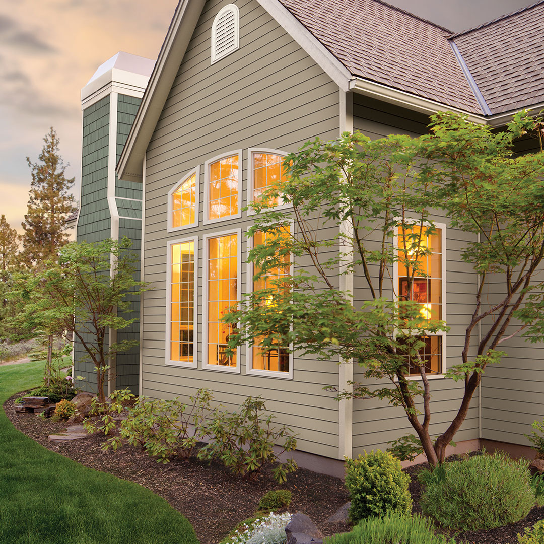 home with trees and residential siding
